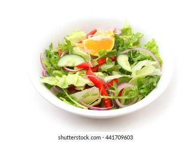 Tossed iceberg lettuce salad isolated on white background