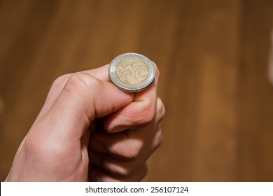 Tossing Euro coin, heads or tails you decide