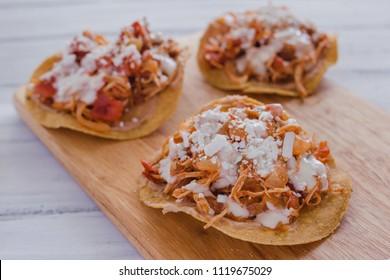Tostadas Mexicanas with chicken, tinga de pollo mexican food in mexico