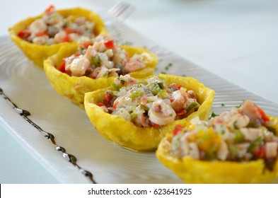 Tostones cup, made of fried green plantain, with octopus spatter