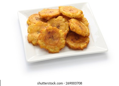 tostones, patacones, fried green plantain banana chips on white background