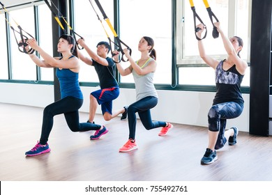 total body resistance exercise TRX trainer training together squat and pull up for whole body muscle workout.