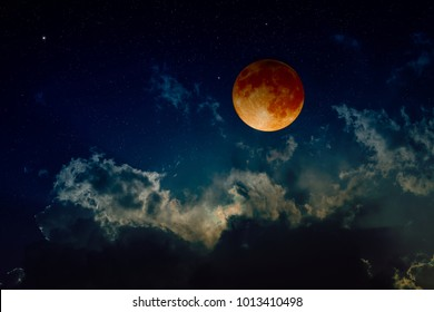 Total lunar eclipse, mysterious natural phenomenon when planet Earth passes between Moon and Sun. Elements of this image furnished by NASA