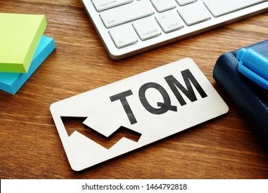Total Quality Management TQM concept.Report on a desk.