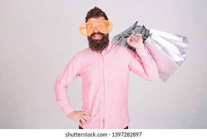 Total sale concept. Man bearded hipster with lot shopping bags. Shopping on black friday. Happy shopping with bunch paper bags. Profitable deal. Shopping addicted consumer. Could not resist discount.