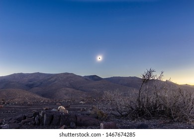 Total Solar Eclipse at Atacama Desert 2 July 2019. A view of the totality phase with the sun corona over Atacama desert mountains. An amazing scenery for an awesome nature event, day becoming night