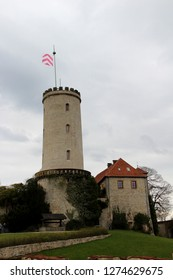 total view on the tower at the sparrenburg in bielefeld germany photographed during a sightseeing tour at a sunny day