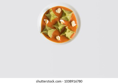 Total white dish with tortelli and almonds