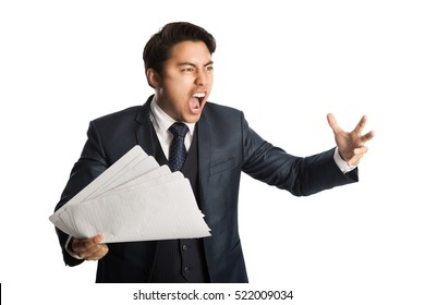 Totally frustrated businessman holding a bunch of paper about to throw them in the air, wearing a blue suit, vest and tie. White background.