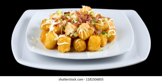 Totchos -Tater tots isolated on black background. Studio Shot