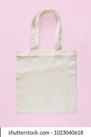 Tote bag canvas fabric cloth eco shopping sack mockup blank template isolated on pastel pink background (clipping path)