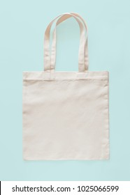 Tote bag canvas fabric cloth eco shopping sack mockup blank template isolated on pastel blue background (clipping path)