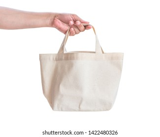 Tote bag canvas white cotton fabric cloth for eco shoulder shopping sack mockup blank template isolated on white background (clipping path) with woman's hand handling handle straps