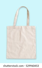 Tote bag fabric cloth shopping sack mockup in isolated on blue mint background (clipping path)