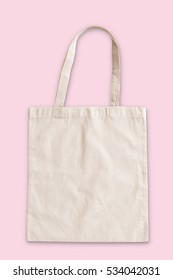 Tote bag fabric cloth shopping sack mockup in isolated on pink background (clipping path)
