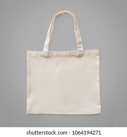 Tote bag mock up canvas white cotton fabric cloth eco shopping sack mockup blank template isolated on grey background (clipping path)
