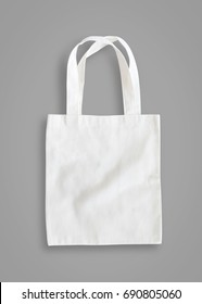 Tote bag mock up or white canvas fabric cloth shopping sack template mockup on grey background