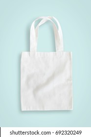 Tote bag mock up or white canvas fabric cloth shopping sack template mockup  on blue background