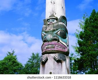 Totem, old totem in  Alaska busch