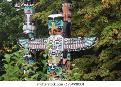 Totem pole of eagle owl wolf at Stanley park in British Columbia Vancouver city. Indigenous Native American art and craft.