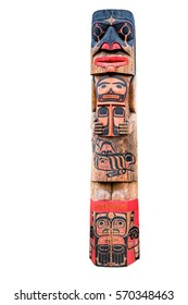 Totem pole with various tribal faces isolated on white background