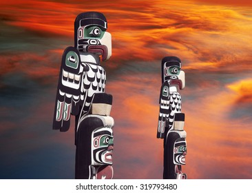 Totems with apocalyptic clouds in Courtenay, Vancouver Island, Canada