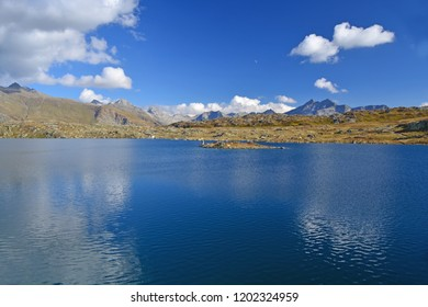 The Totesee lake named after a bloody battle in the Napoleonic Wars, on the Grimsel Pass with the mountains of the Geretal Valley in the distance. In the Swiss Alps