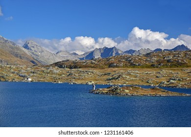 The Totesee lake named after a bloody battle in the Napoleonic Wars, on the Grimsel Pass with the mountains of the Geretal Valley in the distance: Muttenhorner and Punto Rotondo. In the Swiss Alps