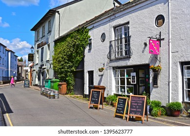 Totnes, Devon / England - 5/4/2019: A pretty row of shops, Maisies café and the rear of the Dartmouth Inn public house located in a street called 'Warland'  close to the town centre.