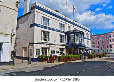 Totnes, Devon / England - 5/4/2019: The Royal Seven Stars Hotel occupies a prominent location in the town centre. Popular with locals & tourist alike it is the perfect spot to sit and people watch!