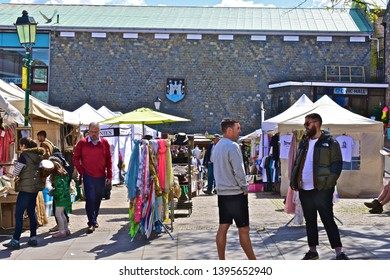 Totnes, Devon / England - 5/4/2019: Street view of local market in the town centre off Fore Street in the centre of Totnes.