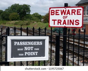 Totnes, Devon, UK - August 27 2018 - Totnes steam train railway station, stopping here for the Wild Breed Farm.  Beware of Trains warning sign