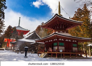 Toto Pagoda (East Tower) in Danjo Garan , Sanmaido Hall, Daiedo hall and Konpon Daito pagoda in the background, covered with snow on a sunny day, town of Koyasan, UNESCO World Heritage area, Japan.