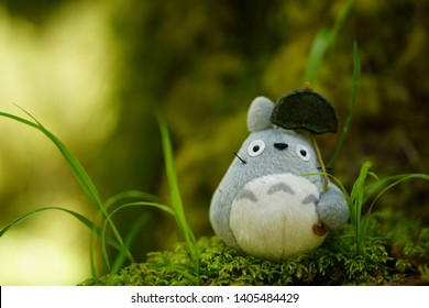 Totoro, a famous Ghibli studio character from Japan, placed on green moss in Rainforest, Olympic national park, Washington state USA. April 30, 2019 - Image