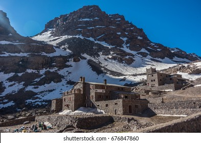 Toubkal national park in springtime with mount, cover by snow and ice, Refuge Toubkal, start point for hike to Jebel Toubkal, a highest peak of Atlas mountains and Morocco