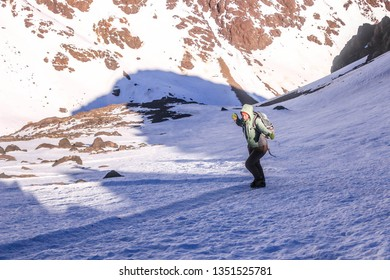 Toubkal/Morocco - 15/12/2018 : Woman girl tourist climbing Toubkal atlas montain in snow
