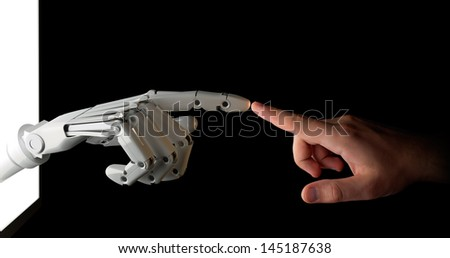 Touch to the Future Hands of robot and human isolated on black.