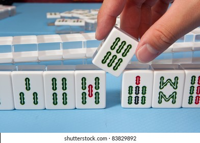 touch a nice mahjong tiles in a game