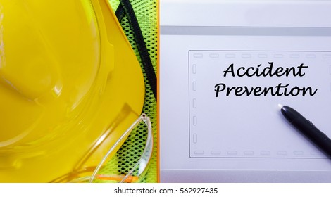Touch pad with yellow safety helmet and safety glass with word Accident Prevention