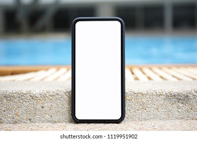 touch phone with isolated screen on background of the pool