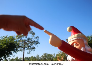 touch or pointing to santa.