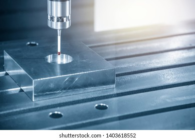 The touch probe attach on the CNC milling machine for finding the centre of part. The CMM  process on machining centre.