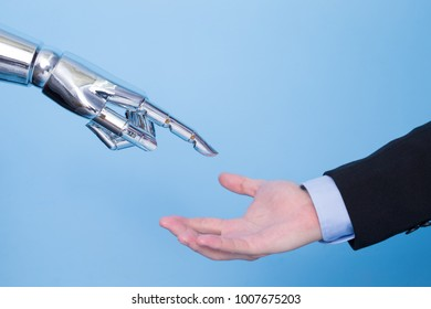 touch with robot hand on the blue bakcgorund