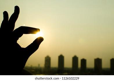 touch the sun in sillhouette concept