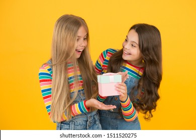 So touched with gift. Thank you so much. Child giving gift box to friend. Kid girl delighted gift. Girls celebrate birthday. Shopping and holidays. Kid happy loves birthday gifts. Dreams come true.