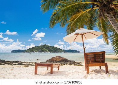 Touched tropical beach in island,Chairs on the beach in summer.