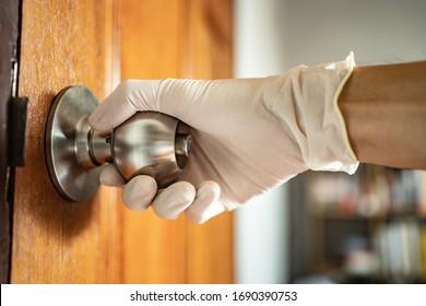 Touching door knob with wearing glove hand