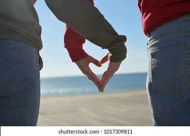 Touching human hands of cheerful people on sunshine beautiful nature outdoors. Lovely valentine harmony, symbolic friendship help. Closeup lifestyle support, dreams holiday travel freedom vacation