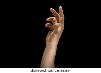 Touching of light. Male hand demonstrating a gesture of getting touch isolated on black studio background. Concept of human emotions, feelings, phycology or business.