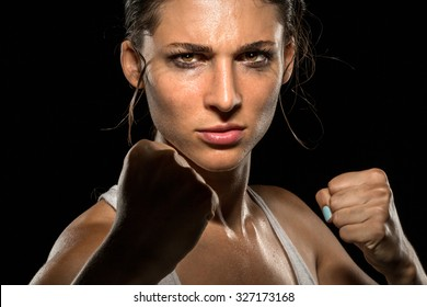 Tough chick powerful strong woman fighter boxer athlete MMA piecing intense eyes stare
